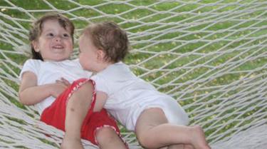 emily and meg on a hammock