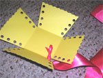 Start lacing the sides with ribbon