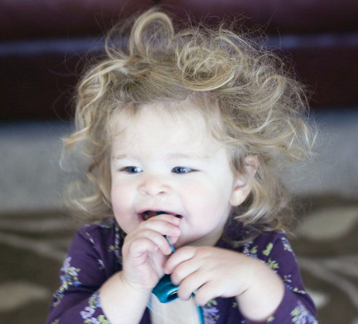 Crazy hair post nap hair she manages to pull it off though